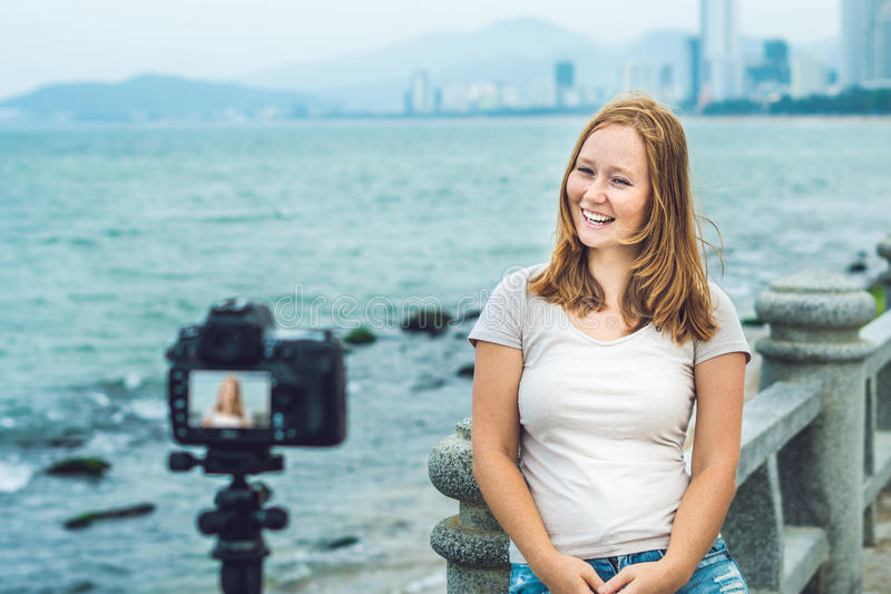 young-woman-blogger-leads-her-video-blog-front-camera-sea-blogger-concept-88822549